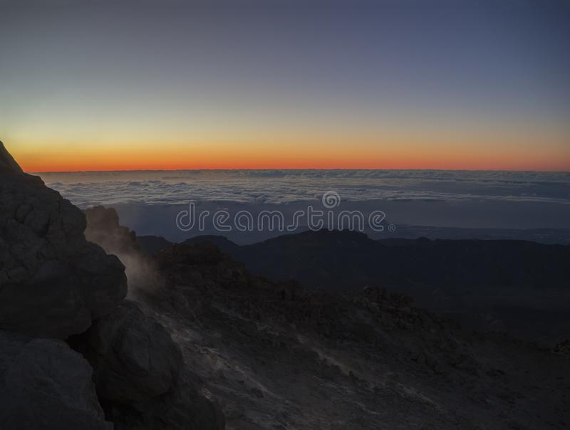Red glow before sunrise on the top of pico del teide vulcano hi royalty free stock image