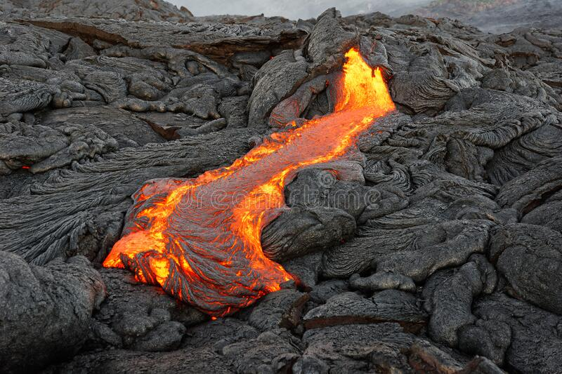 Red glowing lava flow on Hawaii royalty free stock photography