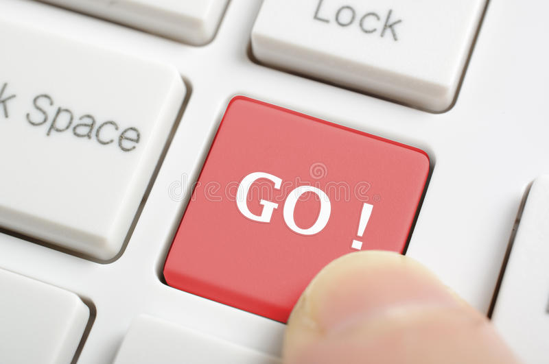 Red go key on keyboard. People pressing red go key on keyboard royalty free stock images