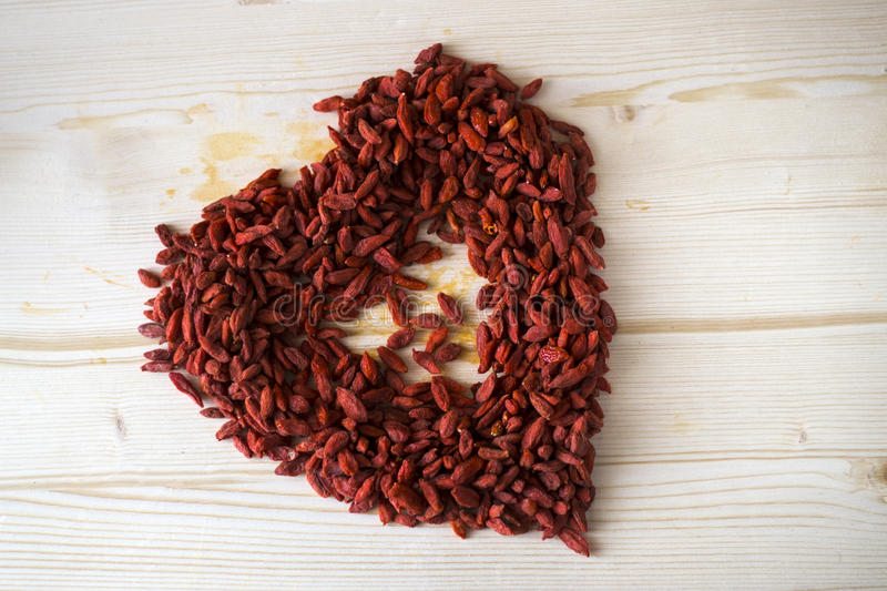 Red Goji berries. Goji berries on the table stock photos