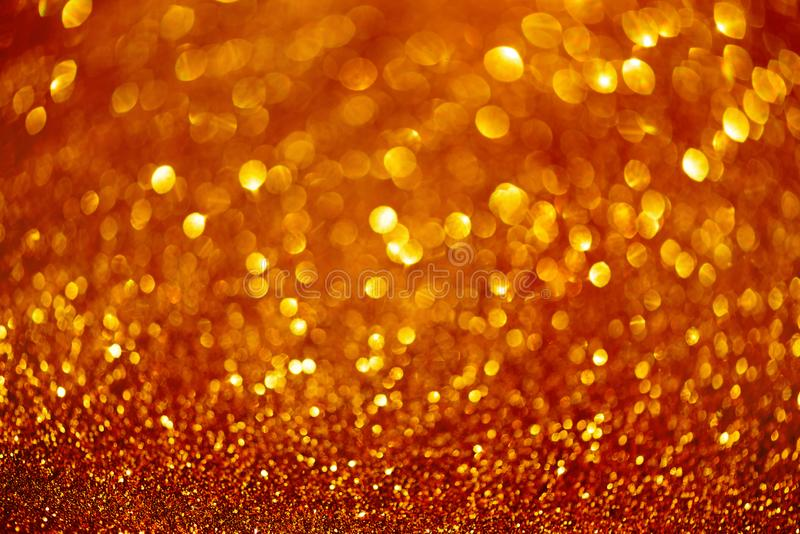 Red and gold abstract bokeh lights. Shiny glitter background with copy space. New year and Christmas concept. Sparkling greeting royalty free stock photography