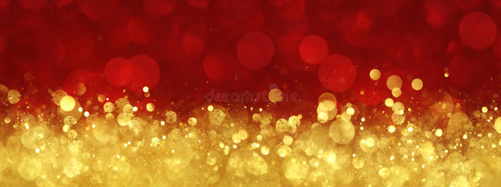 Red and gold abstract Christmas background. Red and gold abstract Christmas bokeh background royalty free stock photography