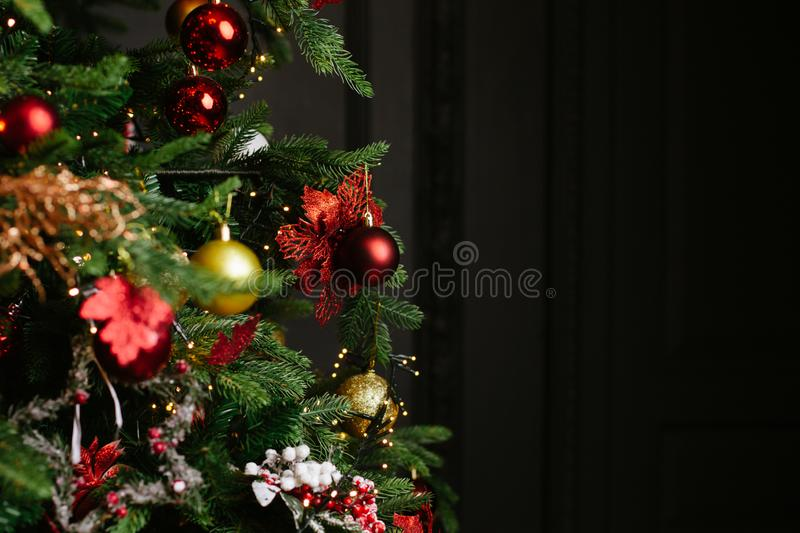 Red and gold balls of Christmas tree decoration in classic and luxury colors on dark background. Happy New Year and Xmas theme stock photo
