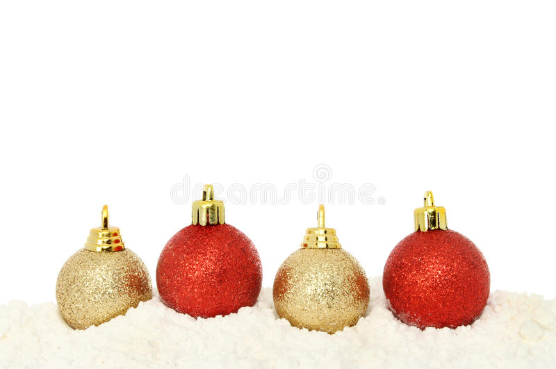 Download Red And Gold Baubles On Snow Stock Photo - Image: 35818924