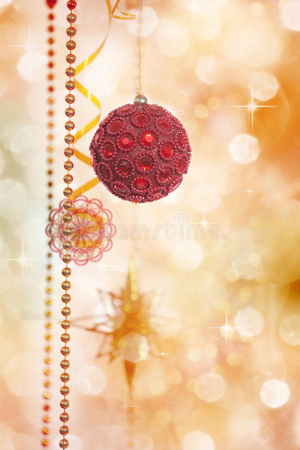Red and Gold Christmas Decoration on Defocused Lights Background royalty free stock photo