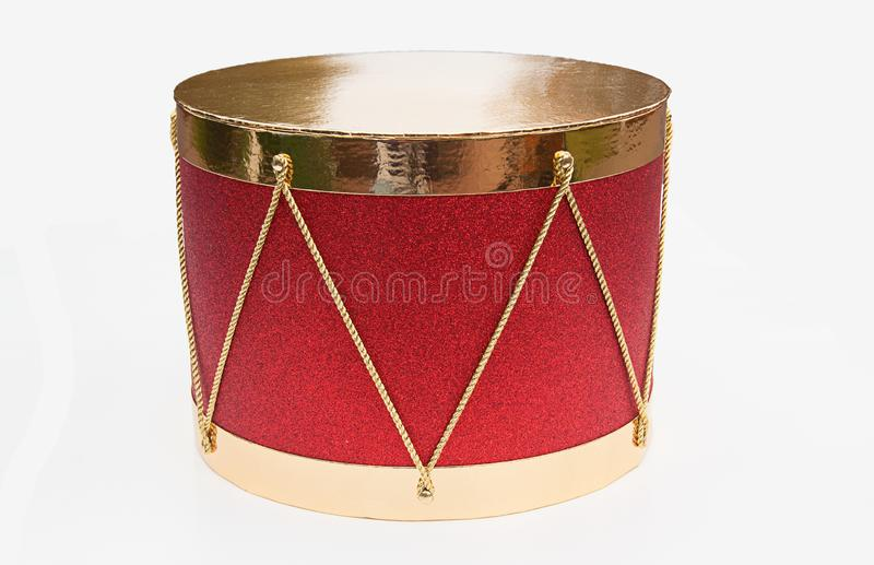 Red and gold drum decor isolated. Perfect for seasonal holiday, Christmas decor on a light background stock images