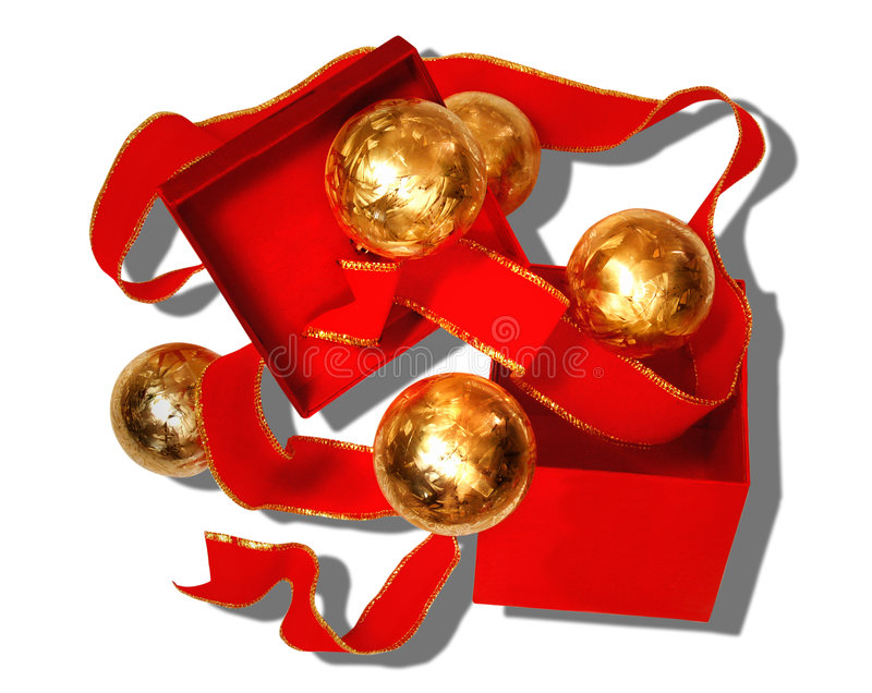 A Red and Gold Holiday. Still life of a red gift box and a joyful explosion of red ribbon and gold Christmas tree ornaments stock photography