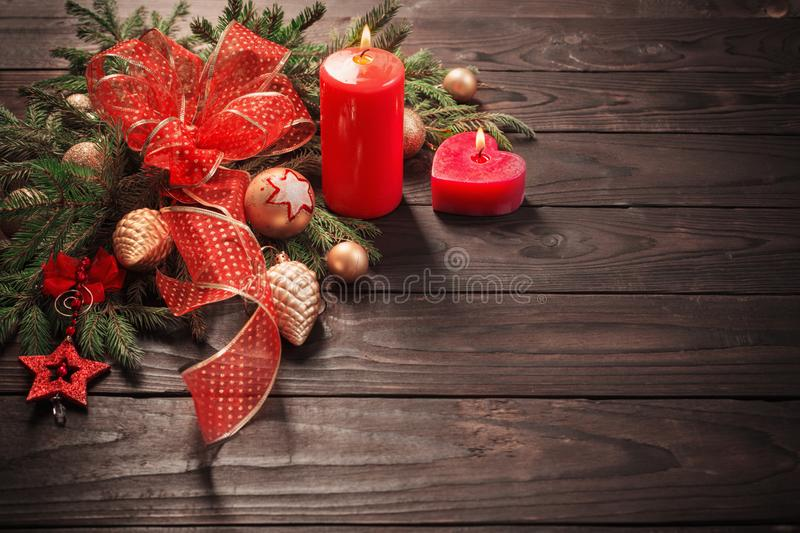 red and golden Christmas decoration with burning candle stock photos