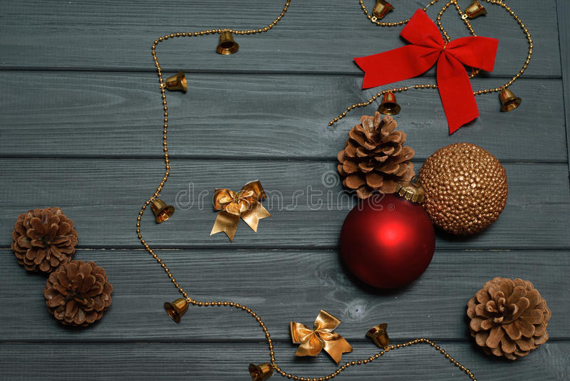 Red and golden Christmas decorations on wooden background stock photos