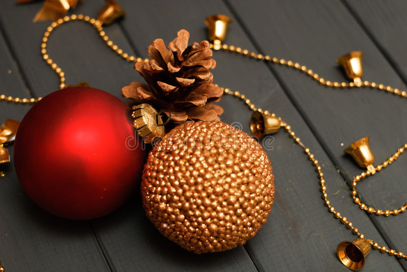 Red and golden Christmas decorations on wooden background stock photo
