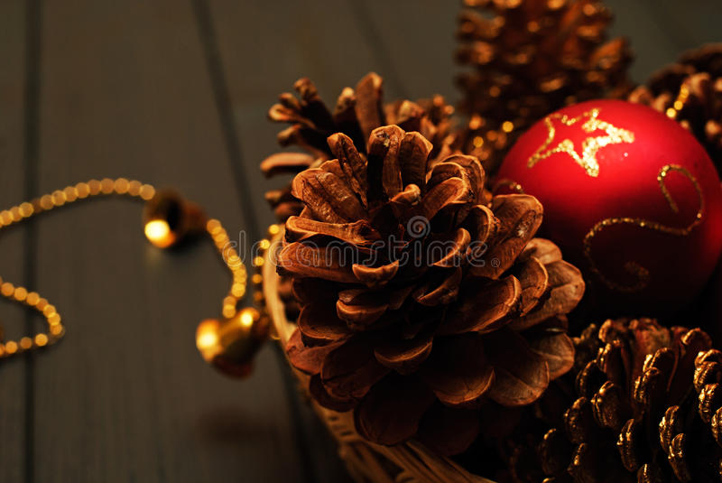 Red and golden Christmas decorations on wooden background stock image