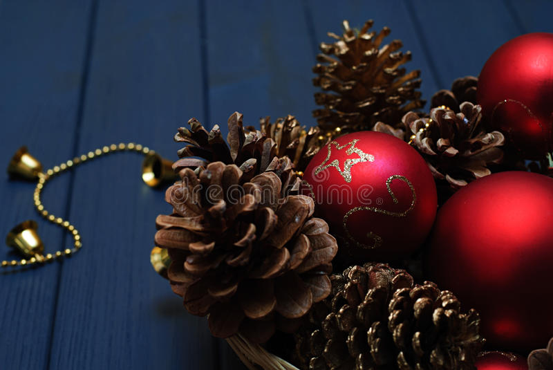 Red and golden Christmas decorations on wooden background royalty free stock photos