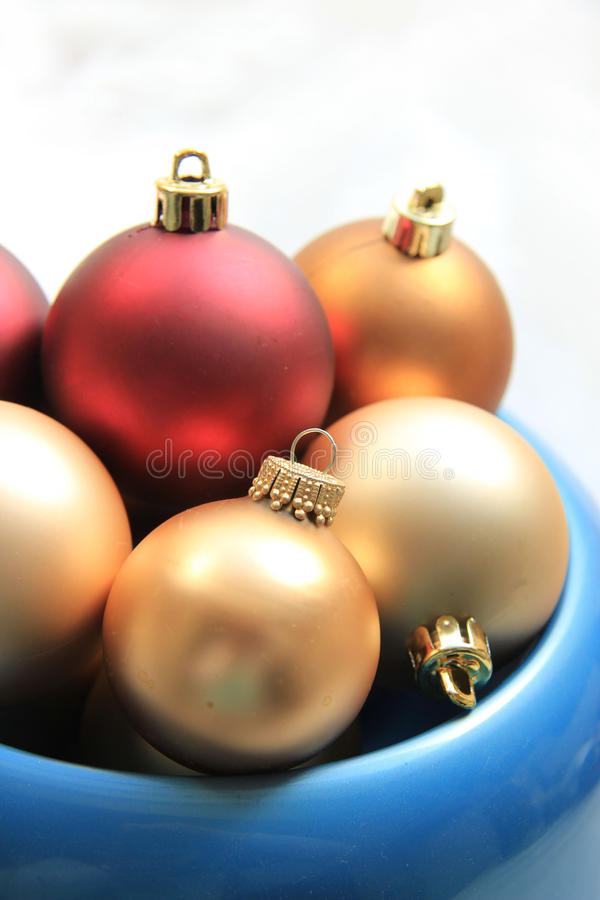 Red and golden christmas ornaments royalty free stock photography