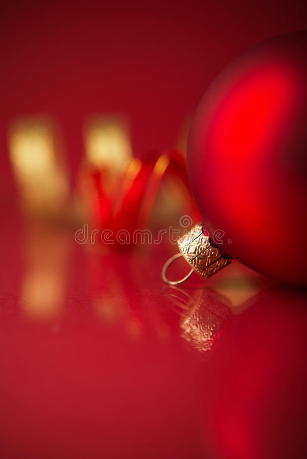 Red and golden christmas ornaments on red background with copy space stock image