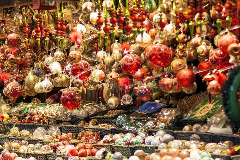 Red and golden christmas tree ornaments and balls, advent market stall close up, photo. Background royalty free stock image
