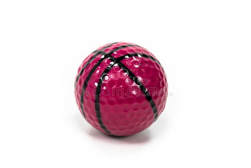 Red golf ball with black stripes on white background. Speckle,spot,dot,point,black line,bar,filament,line,circle,flexible,slick,circular,round,golf ball,golf royalty free stock photo