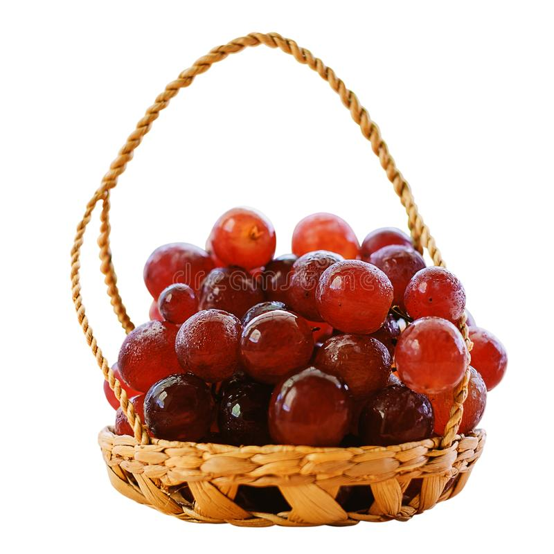 Red grape fruit in the basket isolated on white background stock photo