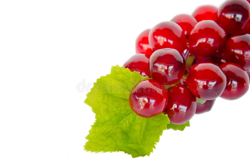 Red grape with leaf on white background. The Red grape with leaf on white background stock photos