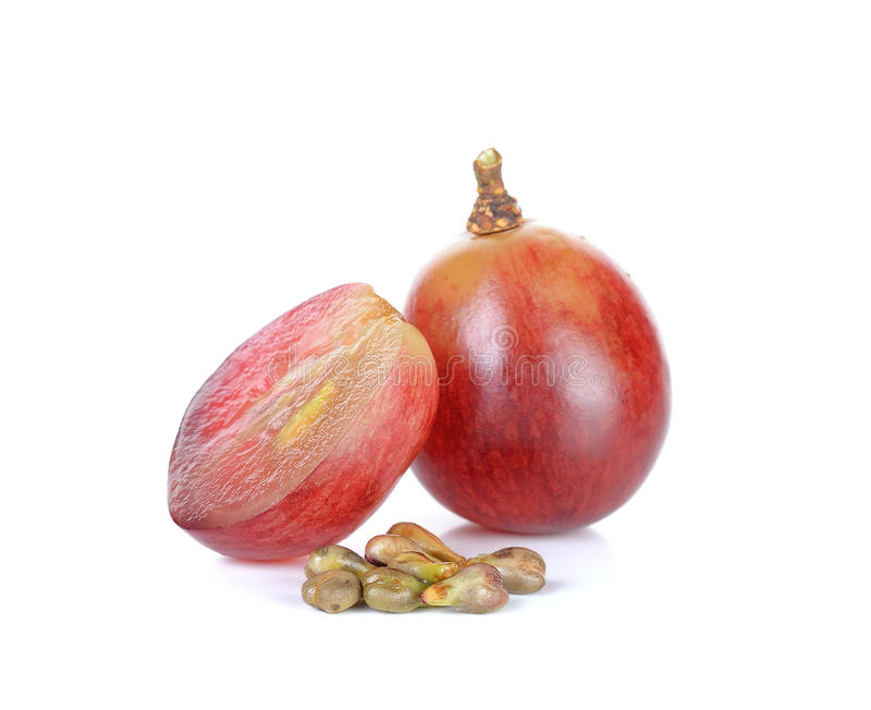 Red grape and seed isolated on the white background stock images