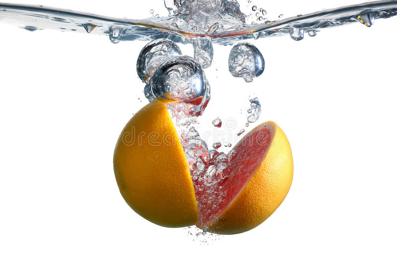 Red grapefruit and bubble stock image