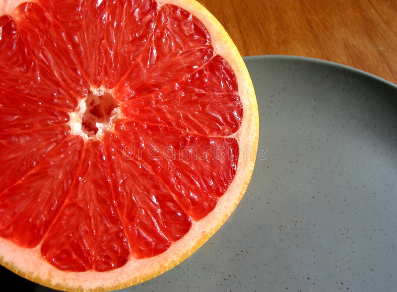 Download Red grapefruit on plate stock photo. Image of vitamins - 457368