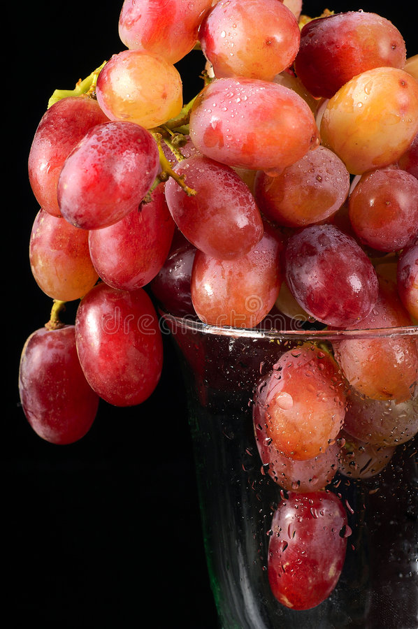 Red grapes in a glass royalty free stock photo