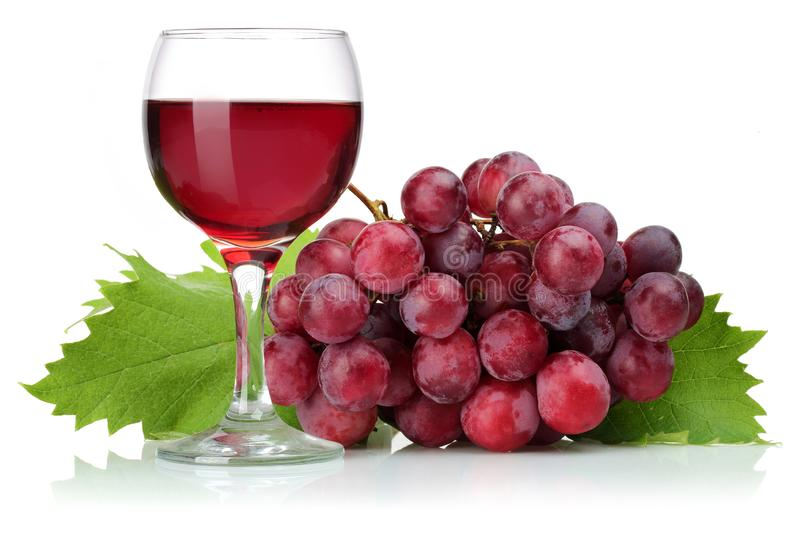 Red grapes and glass of wine with leaves isolated stock photo