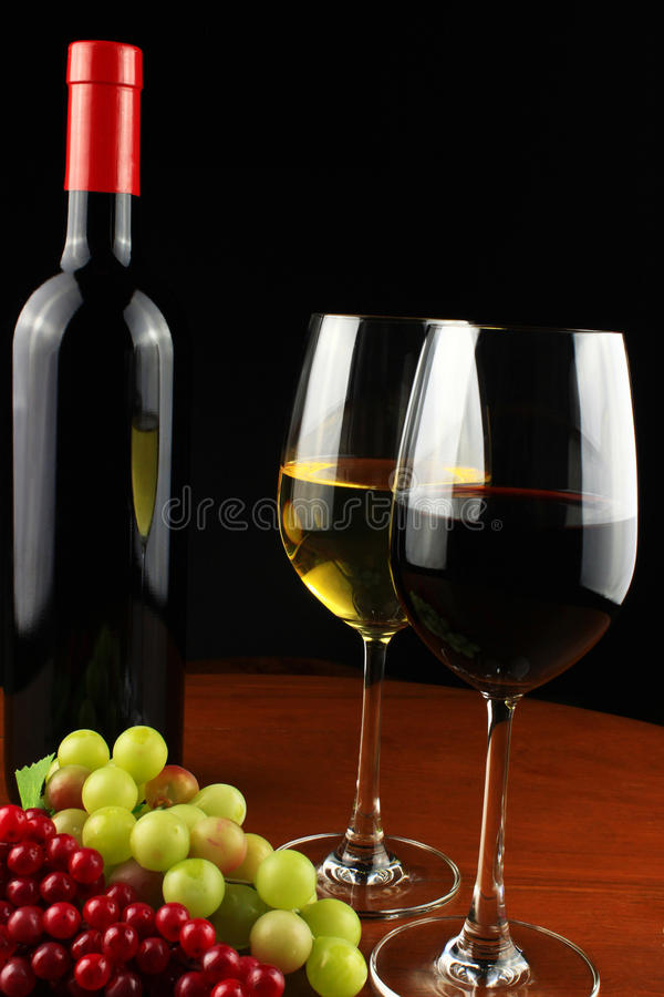 Red grapes and green grapes and wine. stock photos
