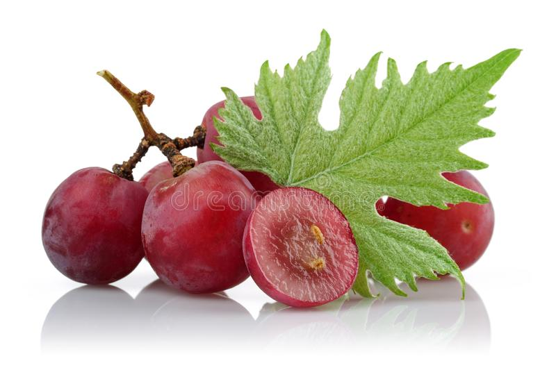Red grapes and half grape with leaf stock photography