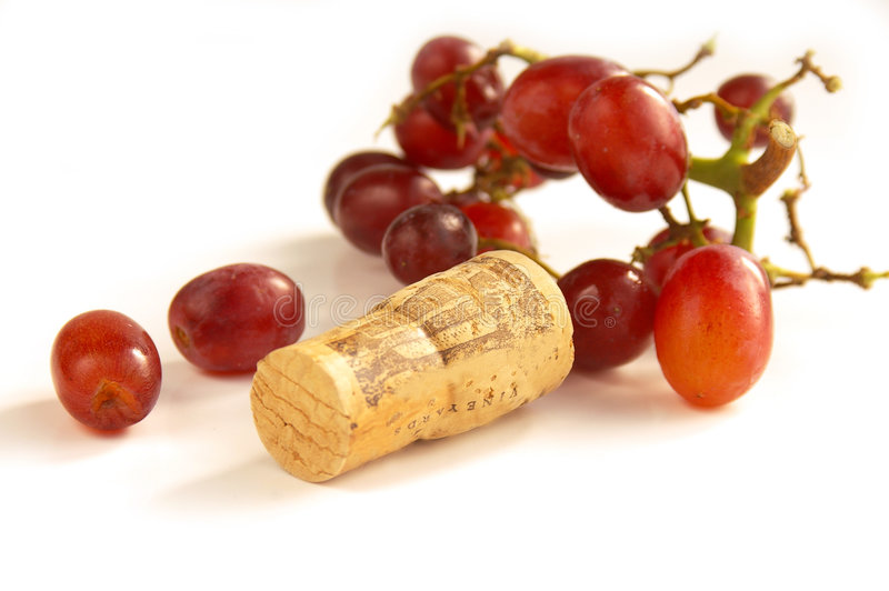 Red grapes with wine cork royalty free stock image