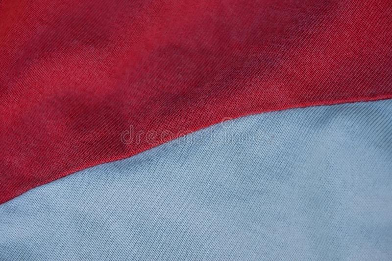 Red gray crumpled cloth background on clothes. Red gray fabric texture of crumpled fabric on clothes stock photography