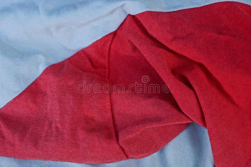 Red gray crumpled cloth background on clothes. Red gray fabric texture of crumpled fabric on clothes stock photos