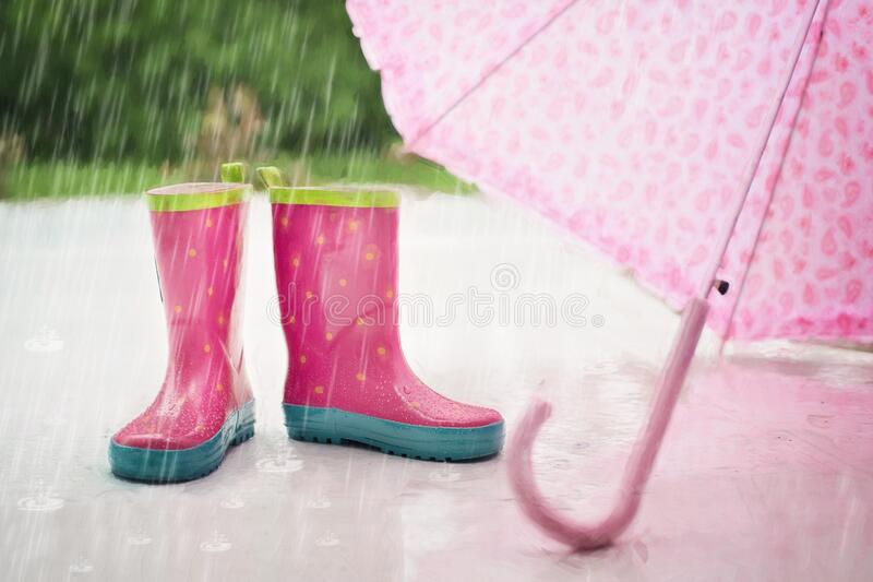 Red and Gray Rain Boots Near Pink Umbrella stock photography