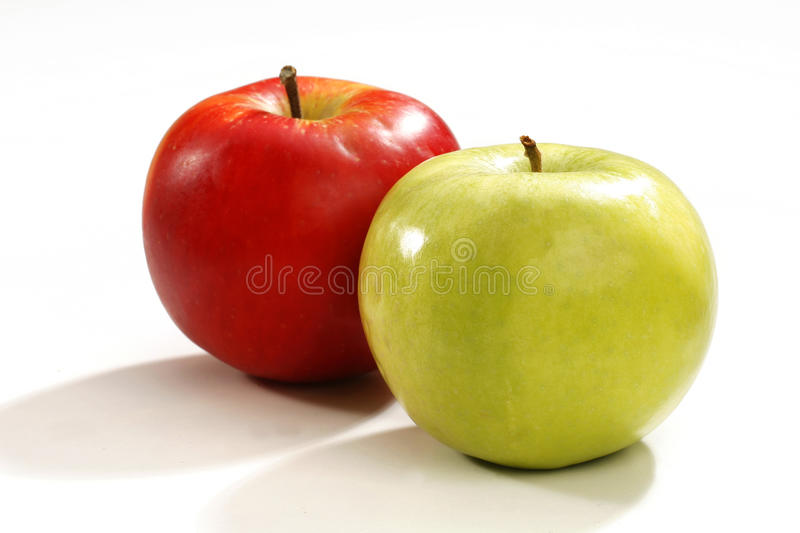 Red and Green Apple. Isolated on white background. Two an aplle royalty free stock photo