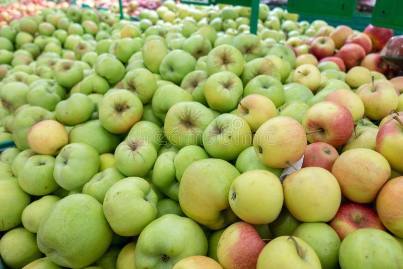 Red and green apple fruits in a supermarket stock photos