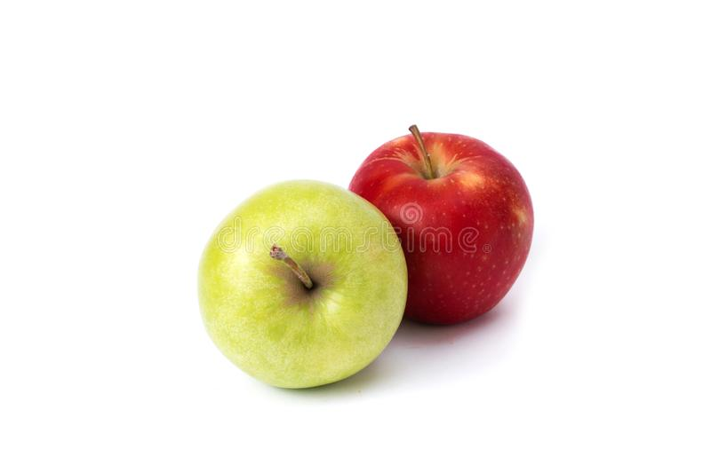 Red and green apple on a white background. Green and red apples juicy on an isolated background. A group of two apples on a white stock photos