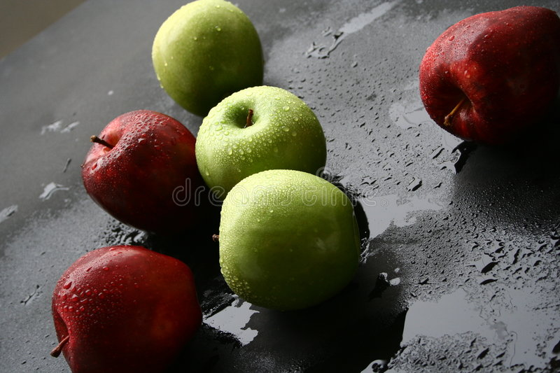 Red & green apples stock photos