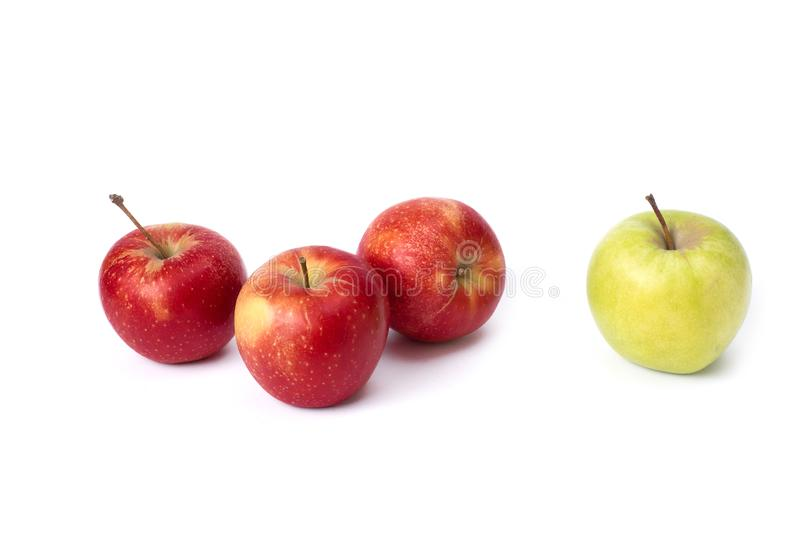 Red and green apples on a white background. Green and red juicy apples on an isolated background. A group of ripe apples on a whit royalty free stock image