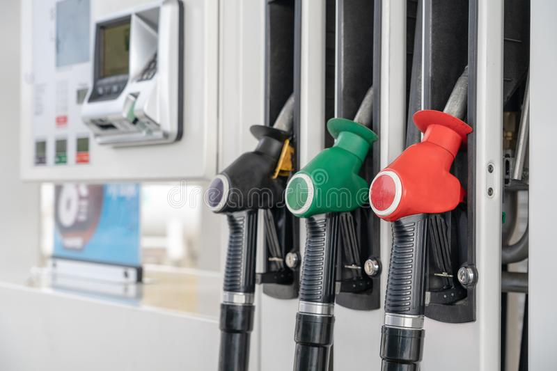 Red green black color fuel gasoline dispenser background. Close-up fuel nozzles on petrol and diesel fuel. stock photo