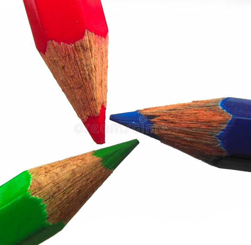 Red green Blue pencils triangle formation showing RGB colour space isolated against white background stock photography
