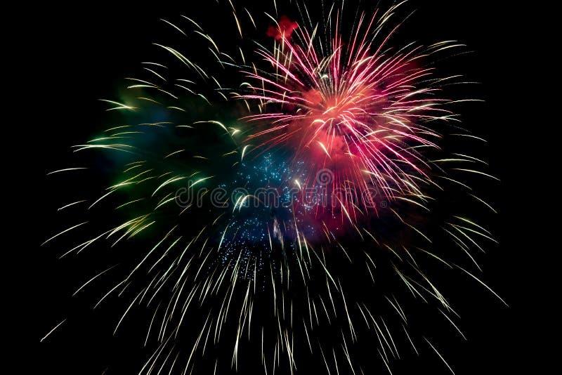 Red Green Blue Sparkling Fireworks Background op Night Scene royalty-vrije stock foto's