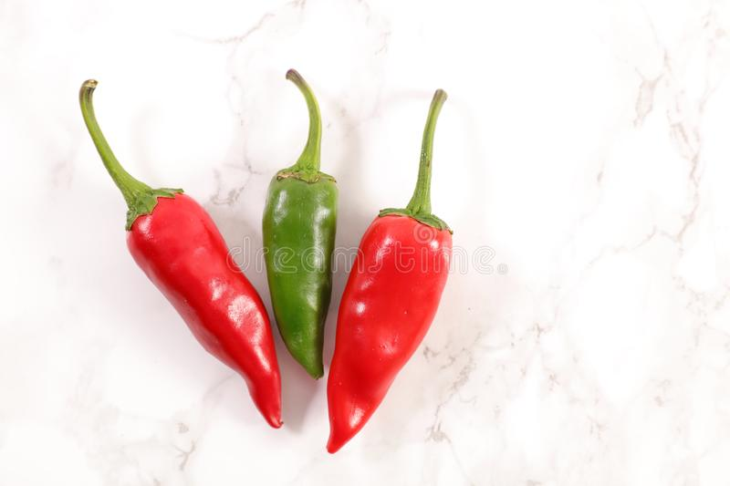 Red and green chili cayenne stock photos