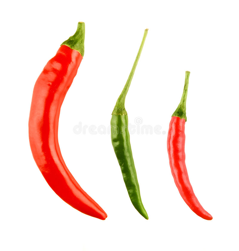 Red and green chilli peppers stock image