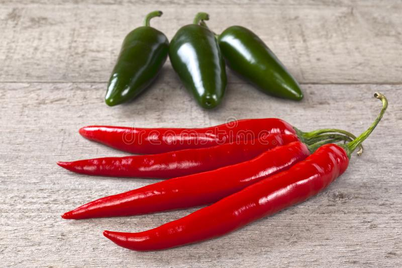 Red and Green Chilli Peppers on Weatherd Wood royalty free stock image