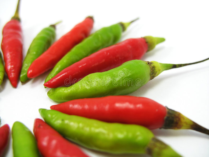 Red Green Chillies. Cili padi arranged in alternating red and green stock photos