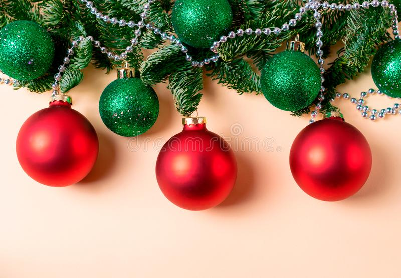 Red and green christmas balls with fir tree branches and silver beads decoration stock images