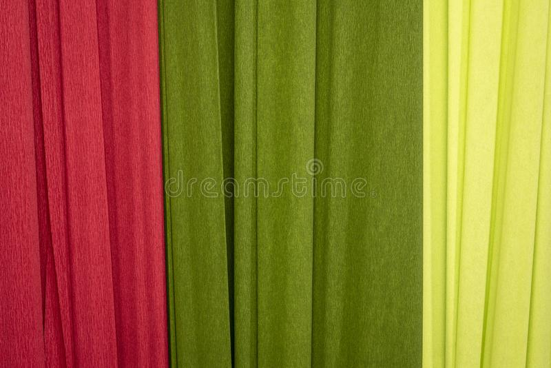 Red and green crepe paper background. Red and green crepe paper - background with crinkled texture royalty free stock photography