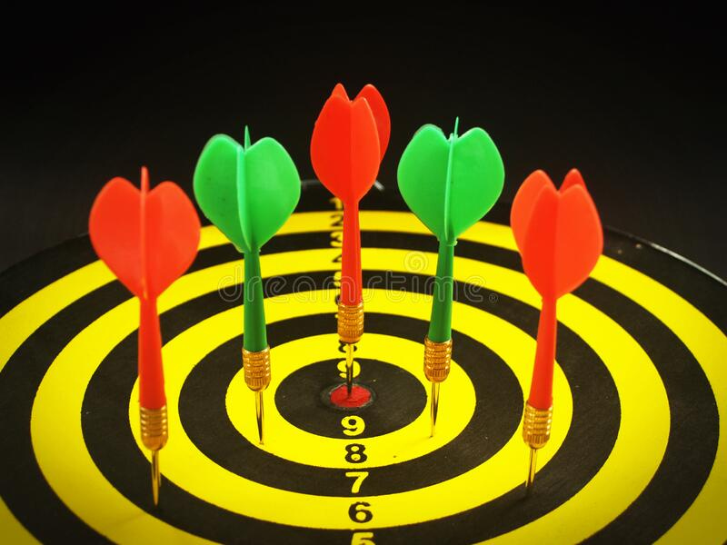 Red and Green Dart Pins on Dart Board stock image