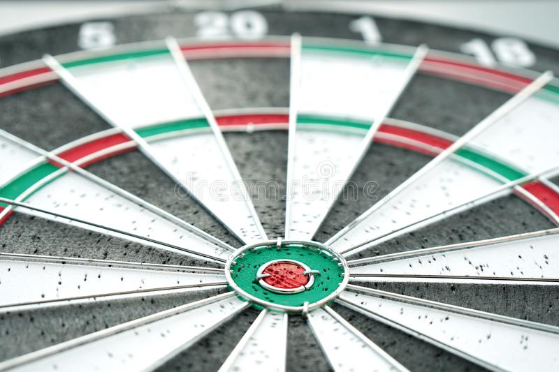 Darts and dartboard arrow game. Red and Green Darts on dartboard arrow game business concept royalty free stock photography