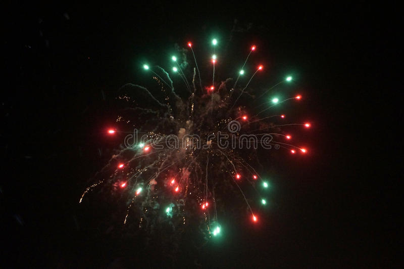 Red and Green Fireworks Burst into the Air royalty free stock photography